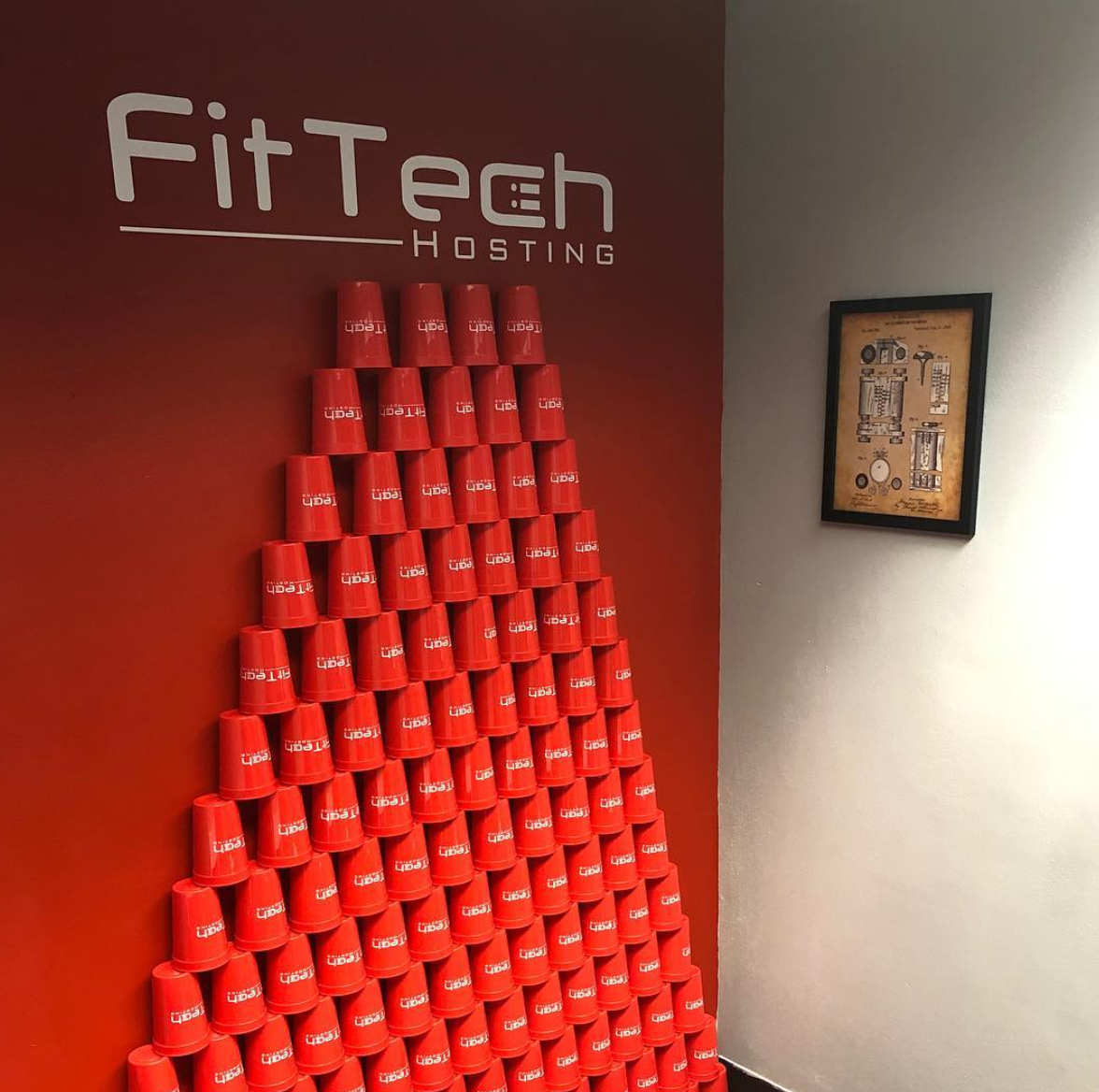 FitTech Hosting Branded Stadium Cups stacked against wall